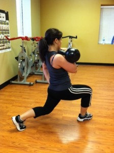 Notice 90 degree bends in both legs, hold the bell in rack position at the chest.