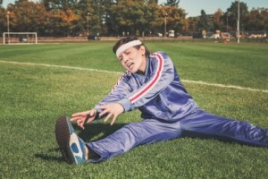 female-athlete-trying-to-stretch