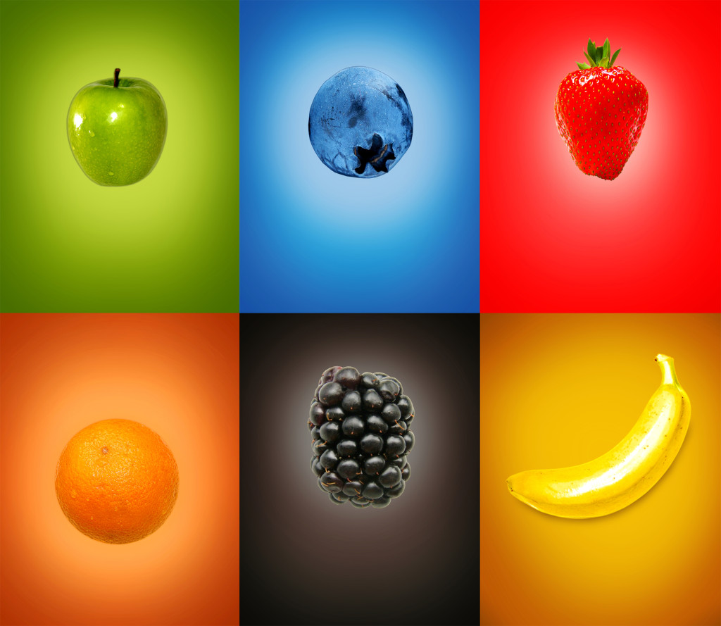 Colorful tasty fresh fruits on multicolor background