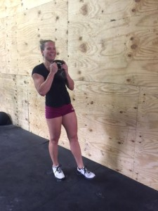 Its best to have fun while squatting. Strongfigure Team Member, Tori Ruckman, helps demo the correct start position for the pistol squat.