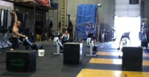 I know its hard to see but I was trying to NOT appear like a creeper. Chris is doing dumbbell snatches, and rowing and box jumps were also part of the instructor mid-day WOD.