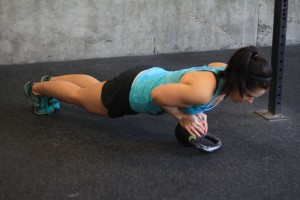 Tricep push-ups: keep your arms close to your body! Your elbows should graze those ribs. Extra challenge? Try it on a kettlebell!