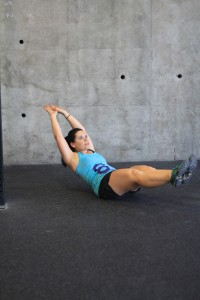 Hollow rocking! Rock from shoulders to feet--keeping your core SUPER tight! Do NOT let your feet touch the ground!