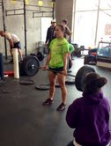 Coaching and judging Olivia through the deadlift portion of the workout.