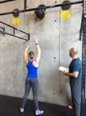 Tori completes her wall balls as Garth counts all 40 repetitions.