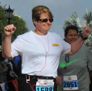 Debi Lantzer, fitness ambassador and runner. Strength through life--for sure a strong figure.