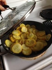 Sauteing squash, from a friend's garden, in a little bit of coconut oil and seasoned with turmeric and Montreal Steak Seasoning.