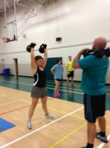 Anne enters beast mode as she hurls not one, but TWO 45-lb kettlebells overhead. I was in awe watching her!