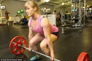 women lift weight