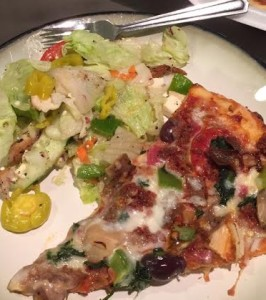 Greek salad with Greek pizza. I dont discriminate when it comes to food. ;)